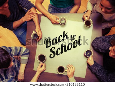 People sitting around table drinking coffee against back to school message