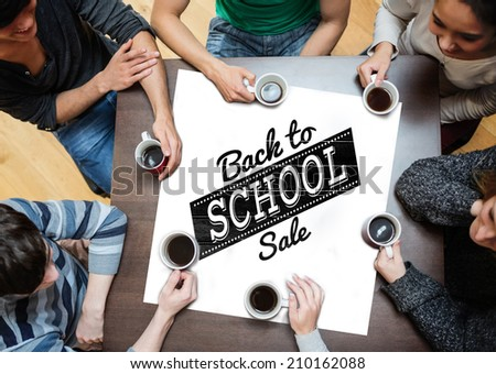 People sitting around table drinking coffee against back to school sale message