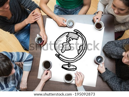 People sitting around table drinking coffee with page showing globe