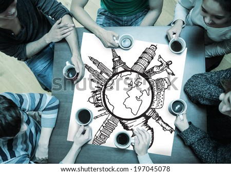 People sitting around table drinking coffee with page showing landmarks around the world