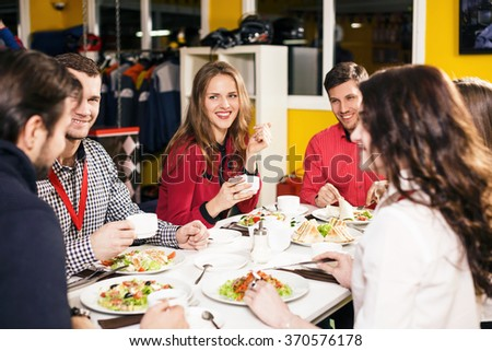 People sitting at the banquet table  - stock photo