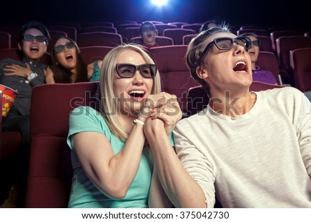 People sitting at the cinema, watching a film. Cinema photo series