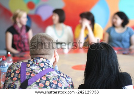 People sitting at the round table - stock photo