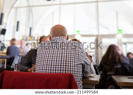 people sitting in cafe  - stock photo