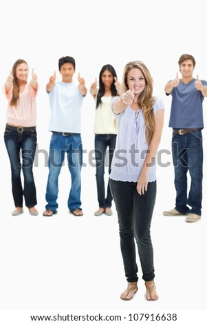 People smiling and approving with one woman in foreground against white background - stock photo