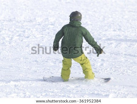 people snowboarding on the snow - stock photo