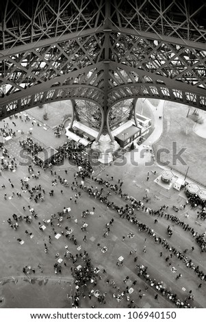 People standing in line under the Eiffel Tower in Paris - stock photo