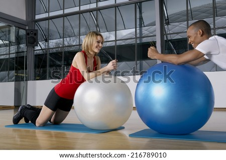 People stretching on the fitness ball.