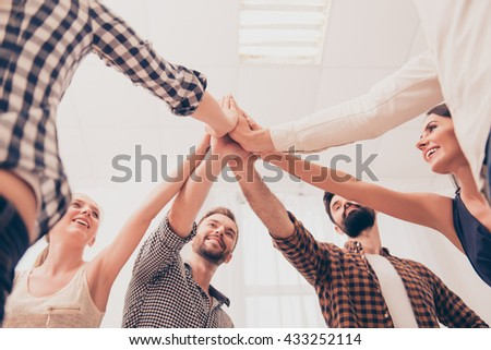 People strong when they together. Many holding  hands clasped together - stock photo