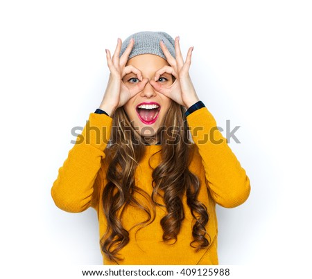 people, style and fashion concept - happy young woman or teen girl in casual clothes and hipster hat having fun - stock photo