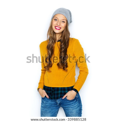 people, style and fashion concept - happy young woman or teen girl in casual clothes and hipster hat - stock photo