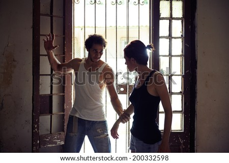 People, substance abuse and domestic violence. Drunk man hurting and hitting his young wife at home - stock photo