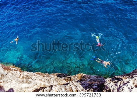 people swimming with snorkel at Cala Pi, Mallorca, Spain - stock photo