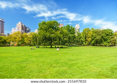 People taking a break in Central Park New York - stock photo