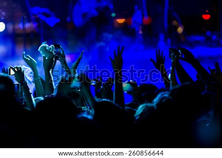 People taking  during a music entertainment public concert - stock photo
