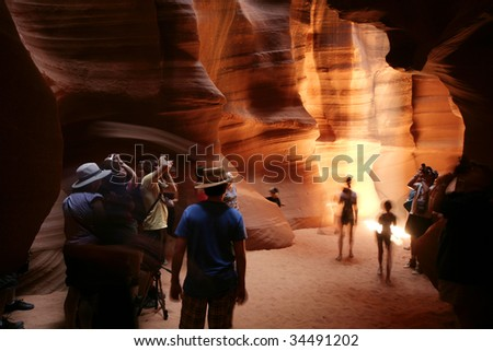 people taking pictures at the upper antelope canyon - stock photo