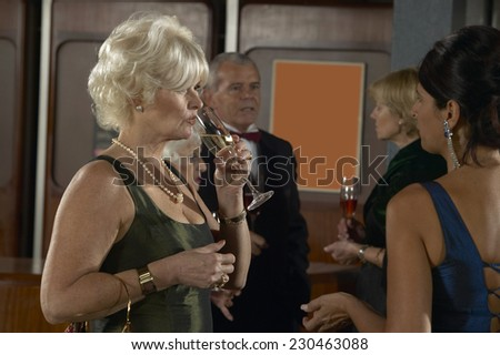 People Talking at Theater Bar - stock photo