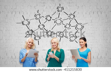 people, technology, communication and leisure concept - happy women with smartphone and tablet pc computers over gray brick wall background with network drawing