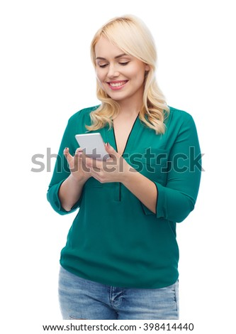 people, technology, communication and leisure concept - happy young woman with smartphone texting message
