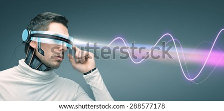 people, technology, future and progress - man in futuristic 3d glasses and microchip implant or sensors over gray background with laser light and electromagnetic waves - stock photo