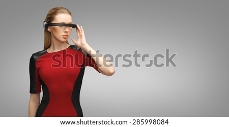 people, technology, future and progress - young woman with futuristic 3d glasses over gray background - stock photo
