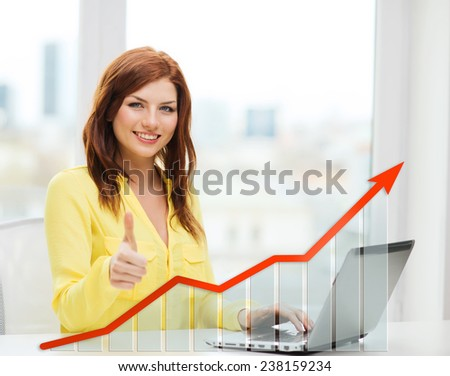 people, technology, statistic sand business concept - smiling woman with laptop computer and growth chart showing thumbs up at home - stock photo