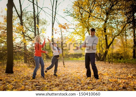 people throw autumn leaves - stock photo