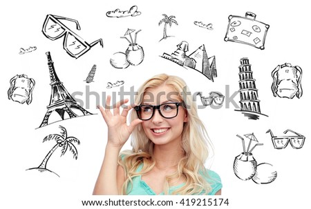 people, tourism, vacation and summer holidays concept - happy smiling young woman or teenage girl glasses over touristic doodles - stock photo