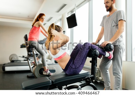 People training abs in gym and working on losing weight