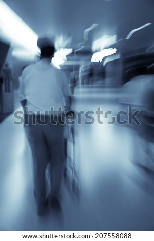 people traveling in the airport in hurry  - stock photo