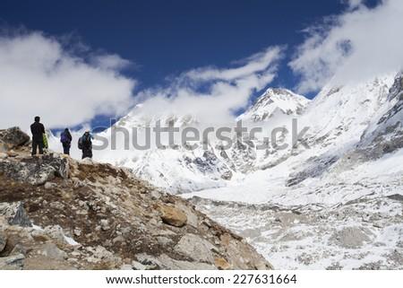 People trekking and climbing in Khumbu area, in Himalayas, Nepal - stock photo