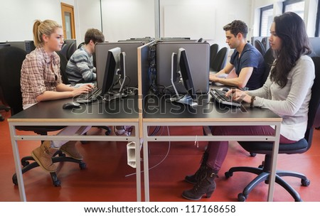 People typing in computer class in college - stock photo