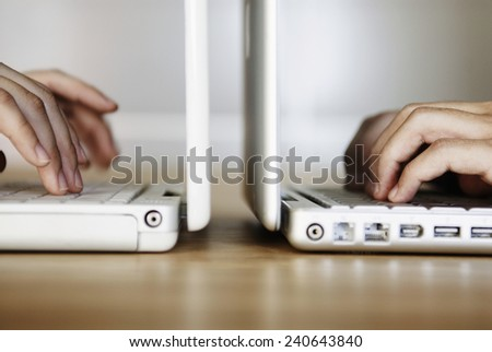 People Typing on Laptop - stock photo