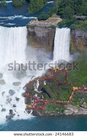 People under the Niagara Fall - stock photo