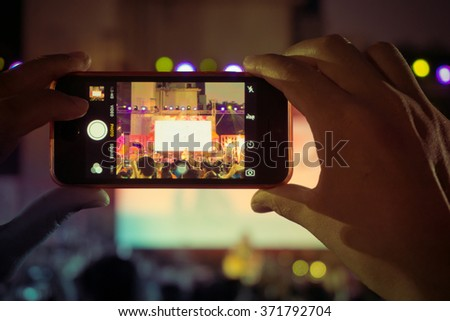 People use smartphone take picture at a concert, Crown of people enjoy - stock photo