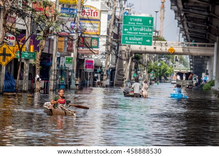 People used boats and trucks to travel during the flooding.This occurs when severe flooding in Thailand,A.D.2011. Shoot 02.21 PM. 09.Nov.2011  Bangkok,Thailand. - stock photo