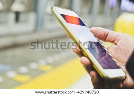 People Using a Smart Phone in subway, communication technology - stock photo