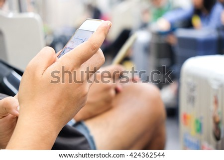 People Using a Smart Phone in subway, Social Media Life,communication technology - stock photo