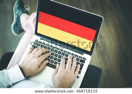 People using laptop and showing on the screen the flag of GERMANY