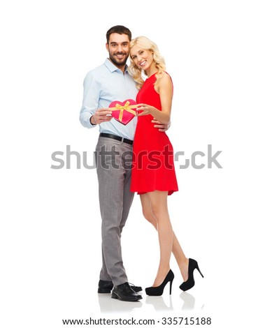 people, valentines day, love, couple and holidays concept - happy young man and woman with red heart shaped gift box - stock photo