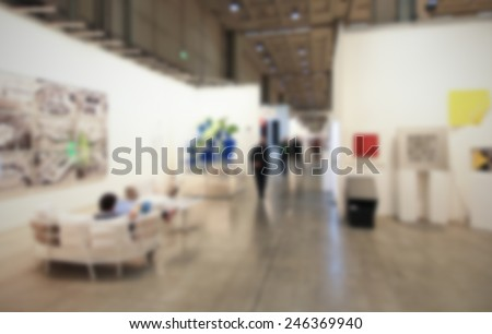 People visit art galleries, background with humans and location not recognizable. intentionally blurred post production. - stock photo