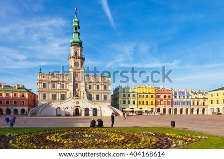 People visitors Main Market square in the Old Town, on April 02, 2016 in Zamosc, Poland. - stock photo