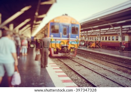 People waiting for the train at the railway station ,train station -soft focus and blur concept - stock photo