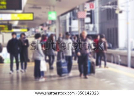 people waiting for the train in station, Japan. Blurred image.