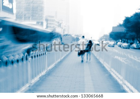 people walk in busy city road blur abstract