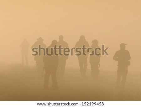 People walk on foggy morning