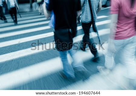 people walk on street - stock photo