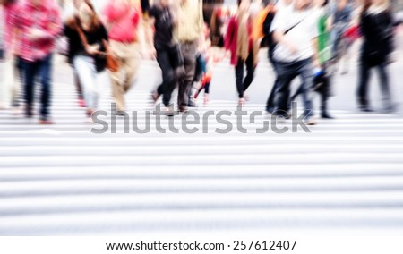 People walk on the zebra crossing
