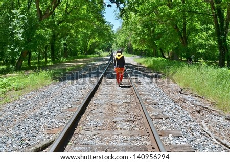 People Walking at Train Tracks at Harpers Ferry in West Virginia USA - stock photo