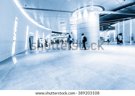 people walking in corridor - stock photo